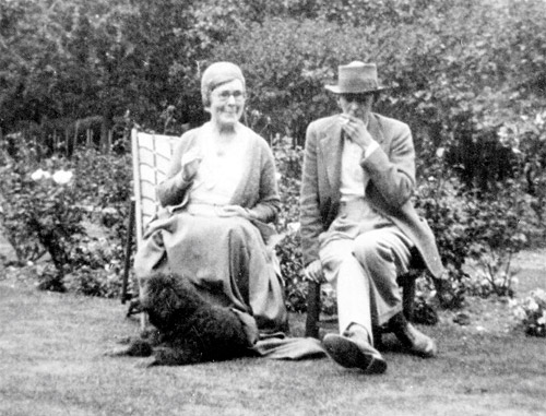 Dorothy Richardson, Alan Odle and dog in a garden